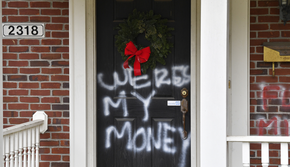 Graffiti is seen on a door of the home of Senate Majority Leader Mitch McConnell, R-Ky., in Louisville, on Saturday.