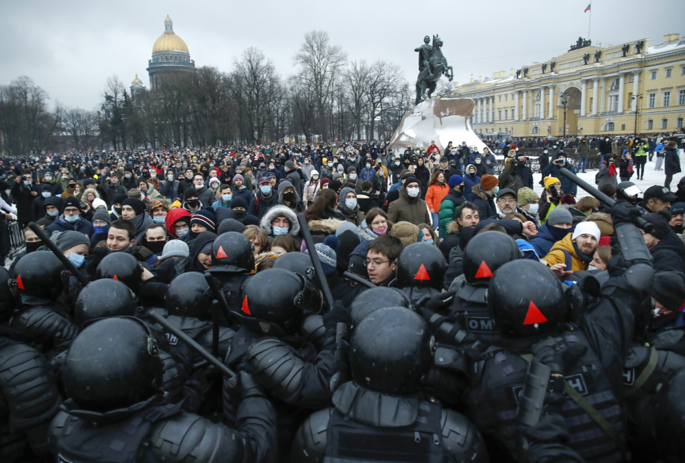 People clash with police during a protest against the jailing of opposition leader Alexei Navalny in St.Petersburg, Russia, on Saturday.