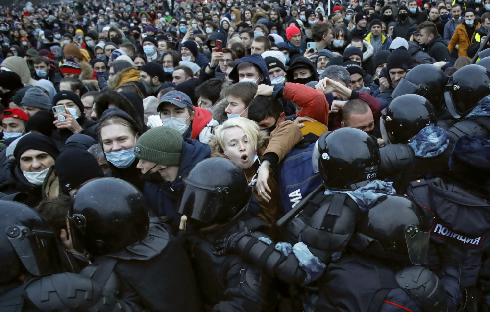 People clash with police during a protest against the jailing of opposition leader Alexei Navalny in St.Petersburg, Russia, Saturday, Jan. 23. Russian police on Saturday arrested hundreds of protesters who took to the streets in temperatures as low as minus-58 F to demand the release of Alexei Navalny, the country's top opposition figure.