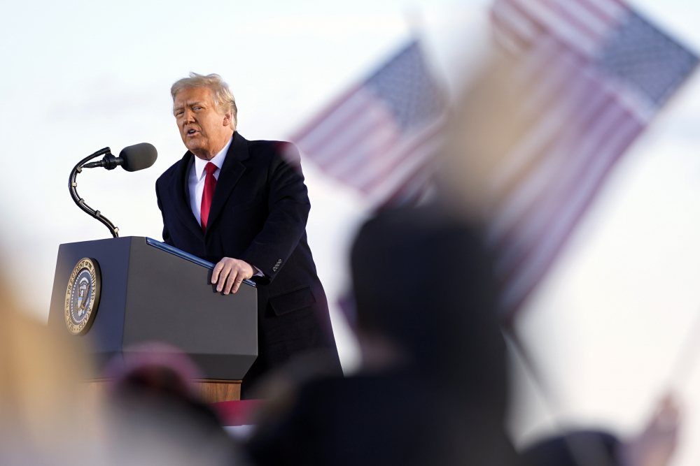 President Donald Trump speaks before boarding Air Force One at Andrews Air Force Base, Md., Wednesday, Jan. 20.