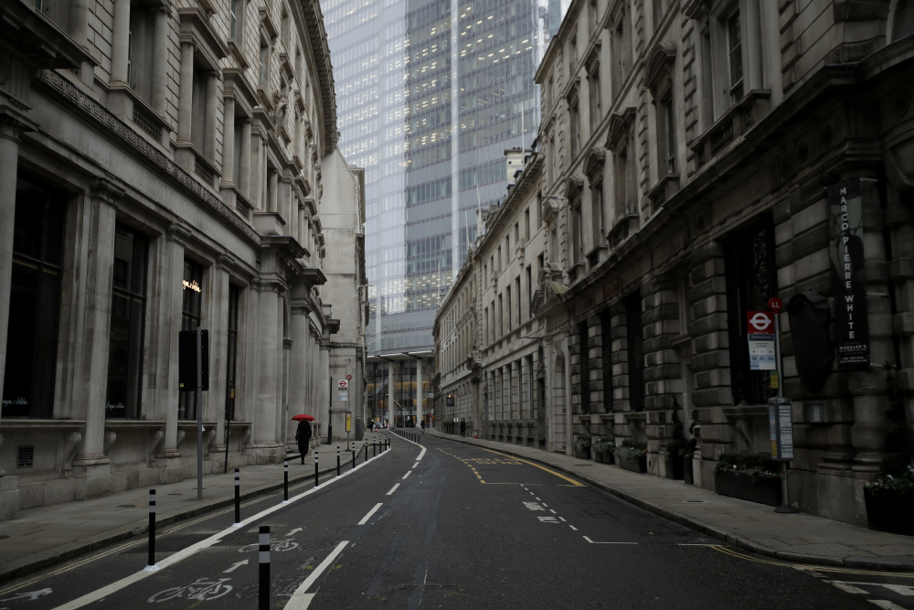 A lone pedestrian walks in the City of London financial district on Monday, the first morning of England entering a third national lockdown since the coronavirus outbreak began.