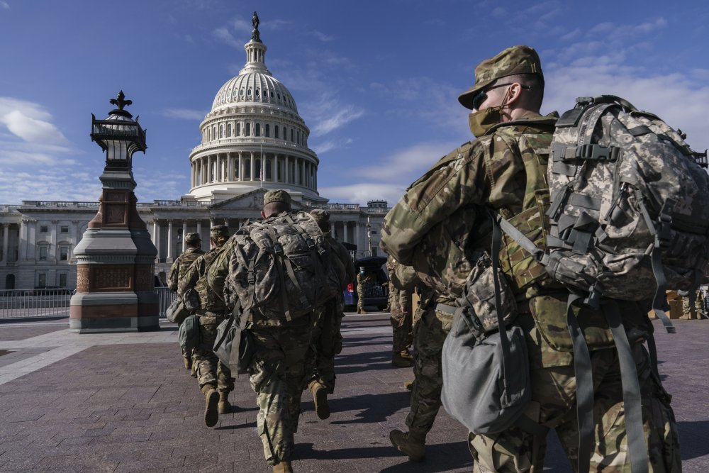 National Guard troops reinforce security around the U.S. Capitol ahead of President-elect Joe Biden's inauguration, in Washington on Sunday,  following the deadly attack on Congress by a mob of supporters of President Trump.