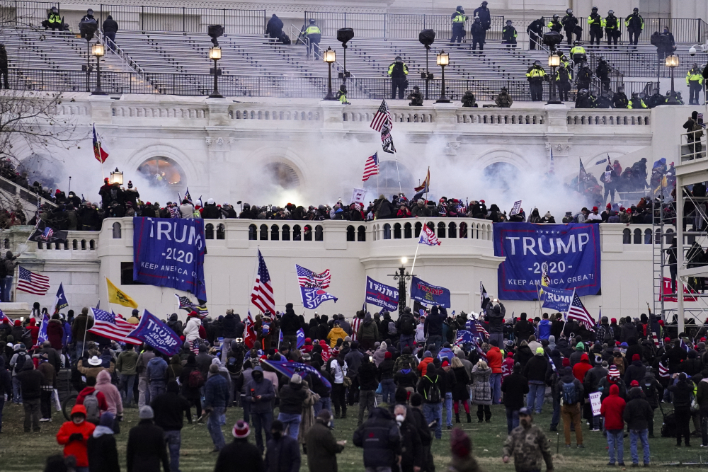 A violent mob, loyal to President Trump, storms the Capitol in Washington on Jan. 6. The FBI says dozens of people on a terror watch list were in D.C. that day.