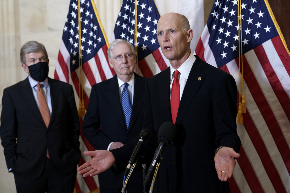 Sen. Rick Scott, R-Fla., joined at center by Senate Majority Leader Mitch McConnell, R-Ky., and Sen. Roy Blunt, R-Mo., speaks to reporters Nov. 10.