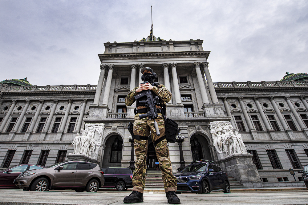 A member of the Pennsylvania Capitol Police stands guard at the entrance to the Pennsylvania Capitol Complex in Harrisburg on Wednesday.