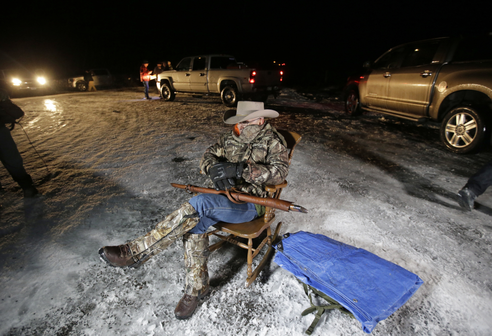 Arizona rancher LaVoy Finicum holds a gun as he guards the Malheur National Wildlife Refuge near Burns, Ore., in 2016. Finicum, one of the leaders of the armed takeover of the refuge, was later shot by state police officers after he fled an attempted police stop. Experts say right-wing extremism like the Malheur takeover had previously mostly played out in isolated pockets or smaller cities in America before the deadly assault by rioters on the U.S. Capitol earlier this month.