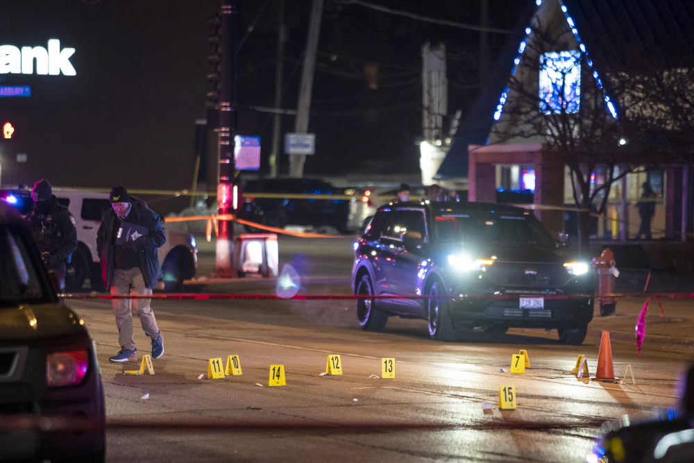 Chicago and Evanston police investigate a crime scene after a gunman went on a shooting spree before being killed by police during a shootout Saturday night in Evanston, Ill.