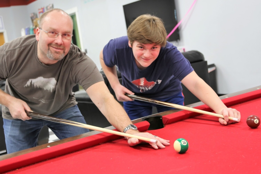 Big Brother Chris Paradis, left, and his Little Brother Evan Jones enjoy playing cribbage, watching movies and, shown here two years ago, shooting pool. Chris and Evan were matched three years ago as part of Big Brothers Big Sisters of Mid-Maine, which is actively recruiting adults in the community, as well as college and high school students, to become Bigs to one of 100 kids waiting to be matched. To learn more about becoming a BBBSMM mentor, call 207-236-BBBS (2227) email info@bbbsmidmaine.org or visit bbbsmidmaine.org.