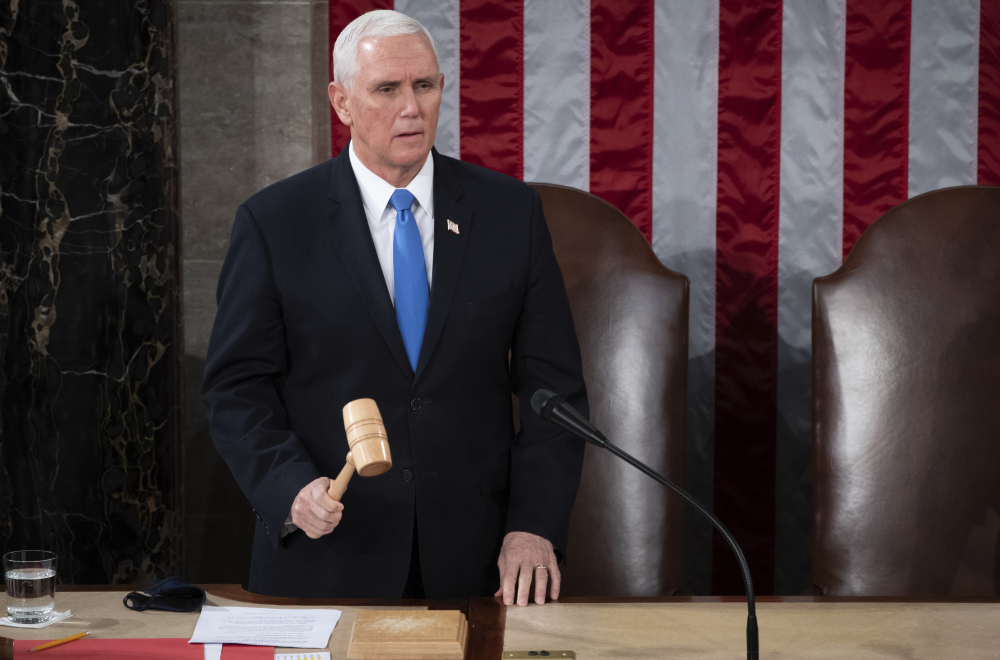 Vice President Mike Pence officiates as a joint session of the House and Senate convenes to confirm the Electoral College votes cast in November's election, at the Capitol in Washington, Wednesday, Jan. 6.