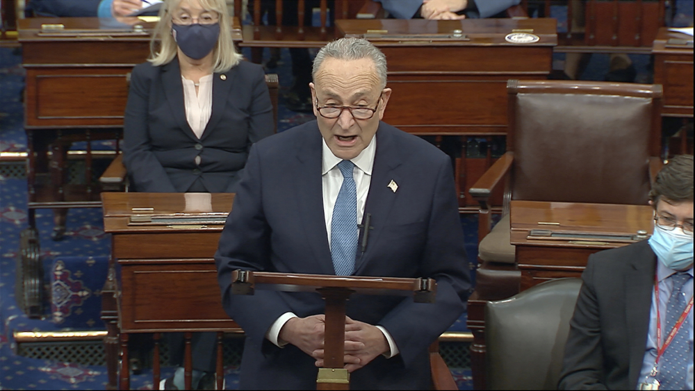 "In this image from video, Senate Minority Leader Chuck Schumer of New York, shown on Wednesday after the Senate reconvened following the Capitol riot, on Thursday called on President Trump to be ""immediately"" removed from office."