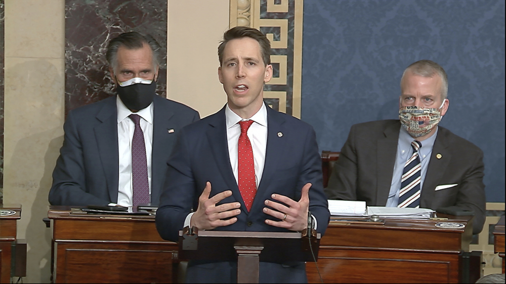 Sen. Josh Hawley, R-Mo., speaks as the Senate reconvenes to debate the objection to confirm the Electoral College Vote from Arizona, after protesters stormed into the U.S. Capitol on Wednesday.