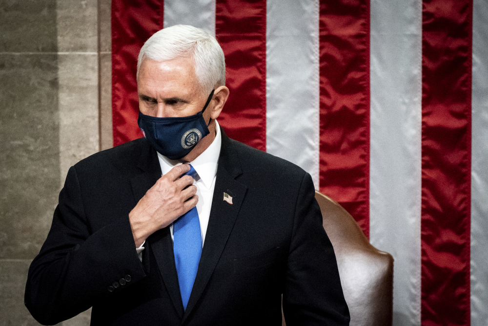 Vice President Mike Pence officiates as a joint session of the House and Senate reconvenes to confirm the Electoral College votes at the Capitol on Wednesday. He has kept a low profile since the insurrection and is expected to spend his remaining days focused on ensuring a peaceful transition of power to President-elect Joe Biden's incoming administration.