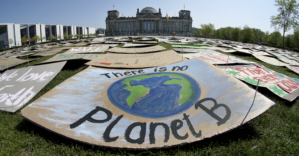 Activists place thousands of protest placards in front of the Reichstag building, home of the german federal parliament, Bundestag, during a protest rally of the 'Fridays for Future' movement in Berlin, Germany in April 2020.