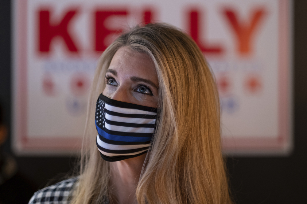 U.S. Sen. Kelly Loeffler, R-Ga., talks to supporters during a campaign event Friday at McCray's Tavern in Marietta, Ga.