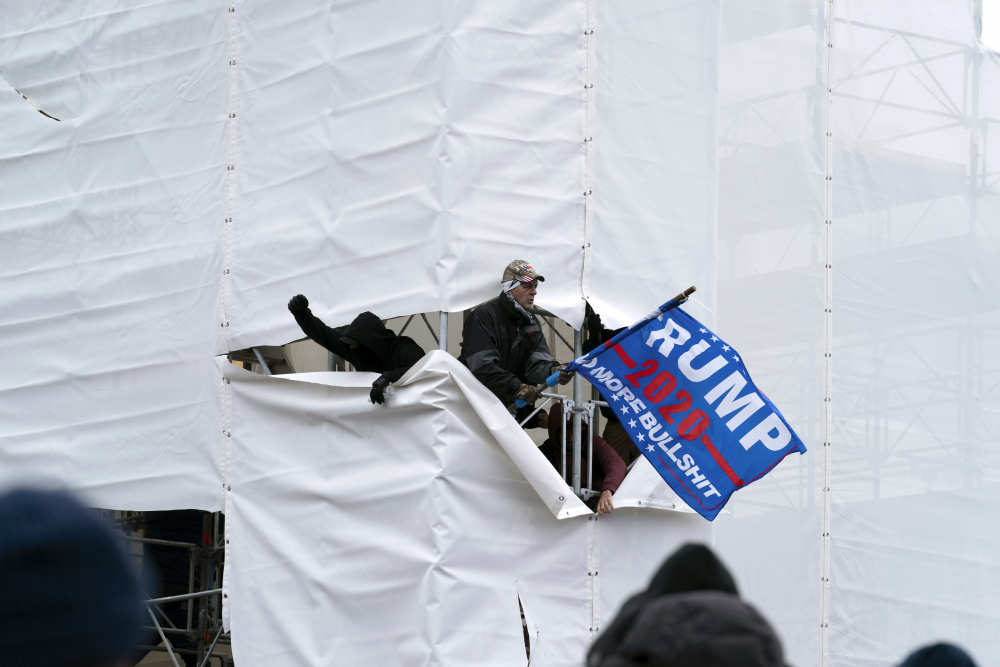 Trump supporters gather outside the Capitol, Wednesday, Jan. 6, 2021, in Washington. As Congress prepares to affirm President-elect Joe Biden's victory, thousands of people have gathered to show their support for President Donald Trump and his claims of election fraud.