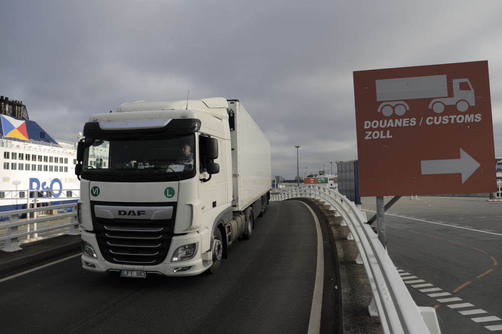 A lorry arrives to board the first ferry heading to Britain after Brexit, Friday in Calais, northern France. Britain left the European bloc's vast single market for people, goods and services at 11 p.m. London time, midnight in Brussels, completing the biggest single economic change the country has experienced since World War II.