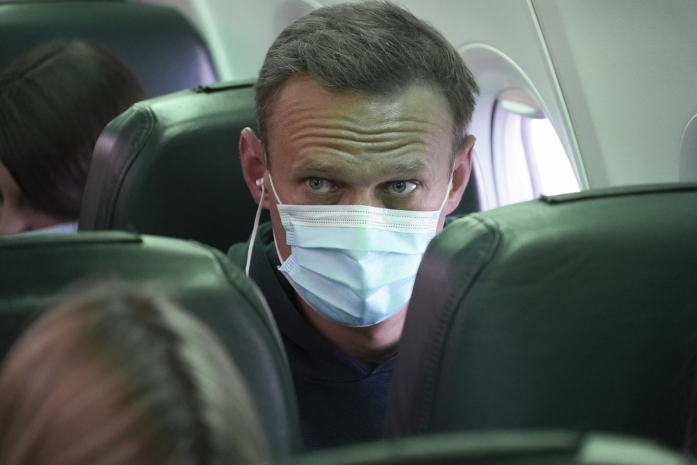 Alexei Navalny sits on the plane prior to a flight to Moscow at the Airport Berlin Brandenburg in Schoenefeld, Germany, on Sunday.