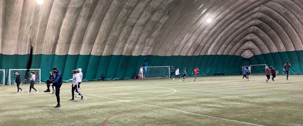The Mt. Ararat indoor track team splits into two groups to accommodate social distancing during their practice on Tuesday at the Topsham Indoor Sports Complex in Topsham.