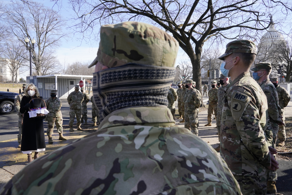 First lady Jill Biden surprises National Guard members outside the U.S. Capitol with chocolate chip cookies on Friday in Washington. Some members of the Maien Guard contingent deployed to D.C. are heading home, but others are going to continue protecting the nation's capital.