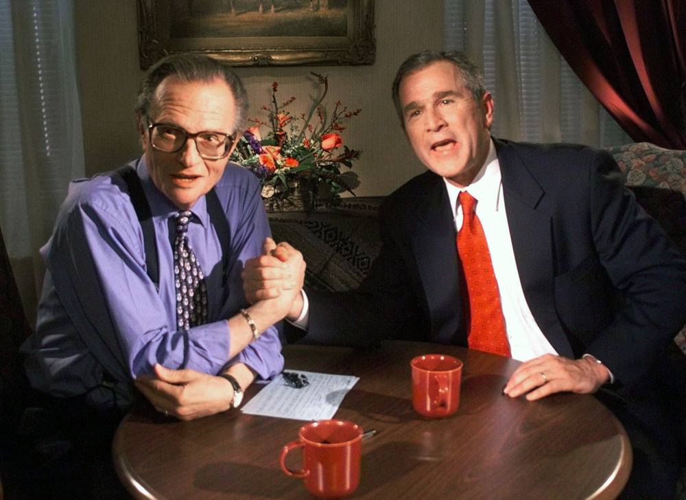 "Republican presidential candidate Texas Gov. George W. Bush jokes with CNN's Larry King after finishing the ""Larry King Live"" show from the Wildhorse Saloon in Nashville, Tenn., in 1999"