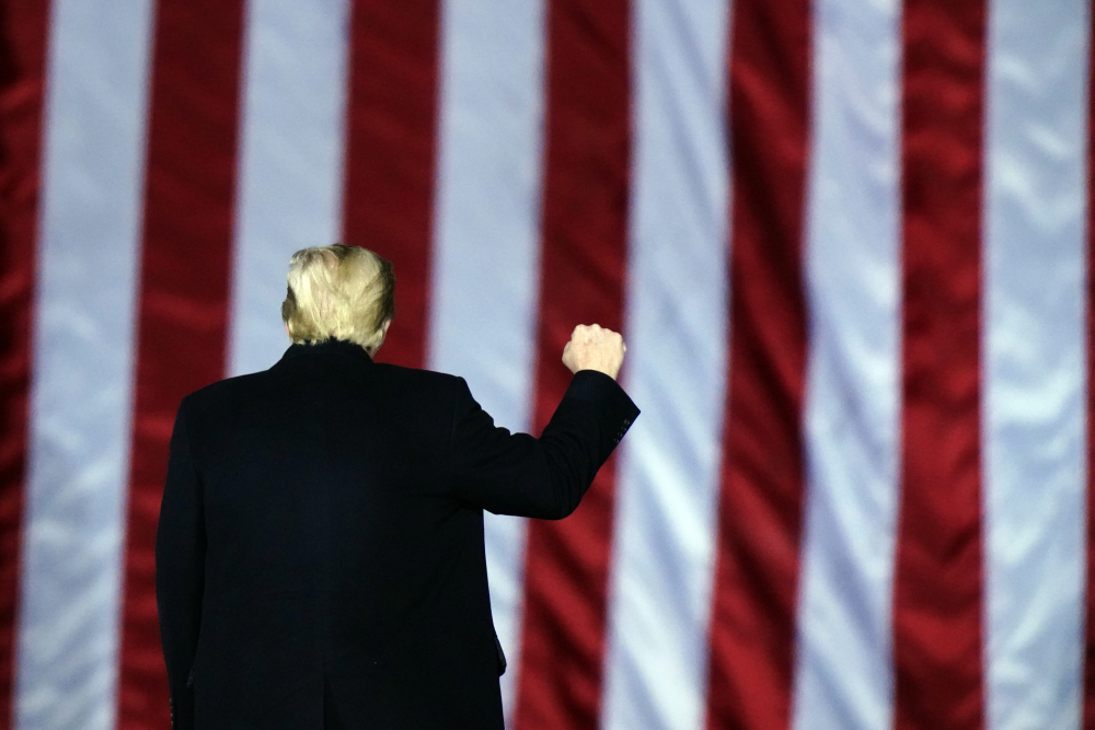 President Trump, shown at a campaign rally this month, has been cut off from the social media channels that have been the lifeblood of his presidency, but will nonetheless try to go on offense in his last days in office, with no plans of resigning.