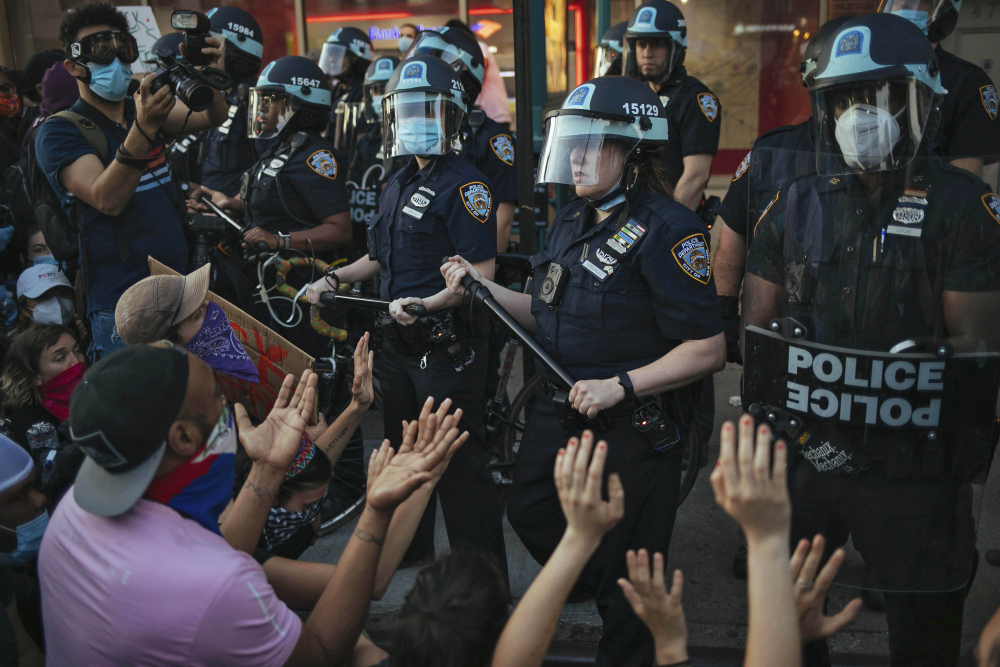 New York City Police face off with activists during a protest march May 31 in the Bedford-Stuyvesant section of the Brooklyn borough of New York.