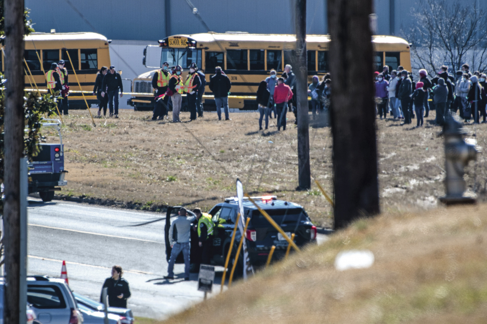 Employees gather outside of the Foundation Food Group site Thursday in Gainesville, Ga., following a liquid nitrogen leak that killed six people.