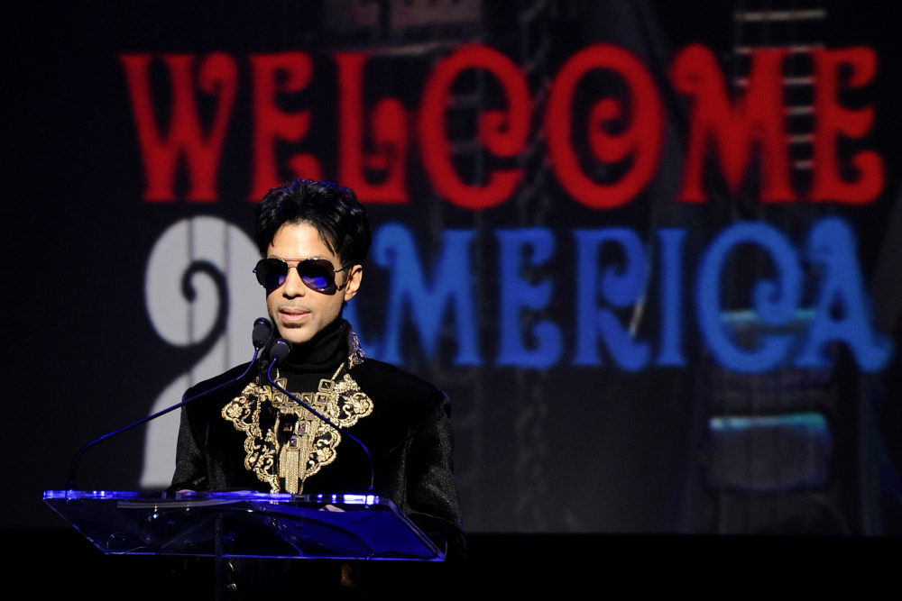 "FILE - In this Oct. 14, 2010 file photo, musician Prince holds a news conference at The Apollo Theater announcing his ""Welcome 2 America"" tour in New York on Oct. 14, 2010. Internal Revenue Service calculations showed that executors of the rock star's estate undervalued it by 50 percent, or about $80 million."