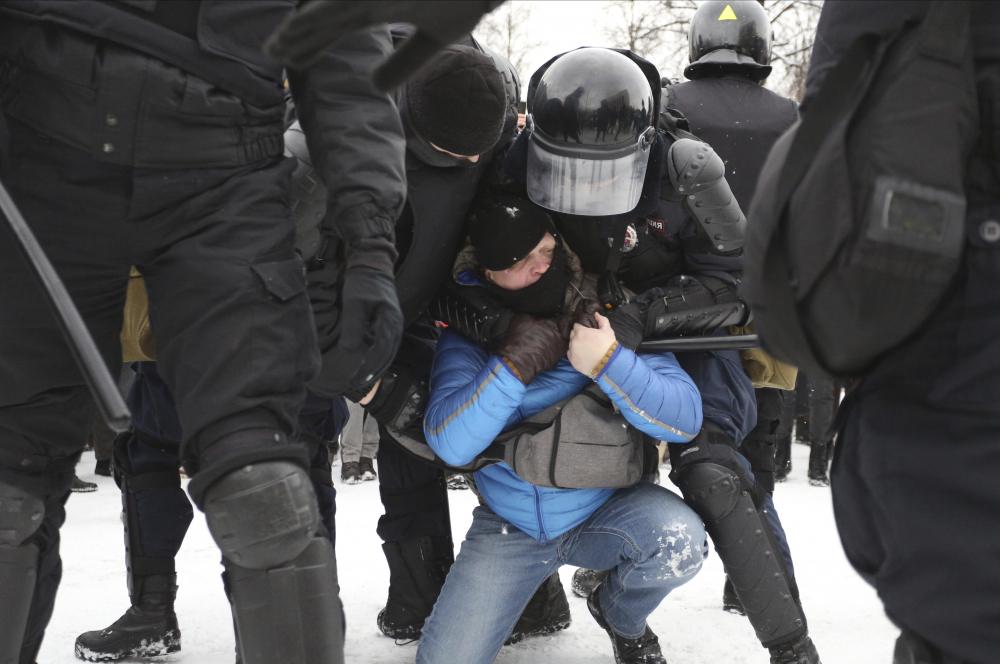 Police detain protesters during a demonstration against the jailing of opposition leader Alexei Navalny in St. Petersburg, Russia, on Sunday. (AP Photo/Valentin Egorshin)