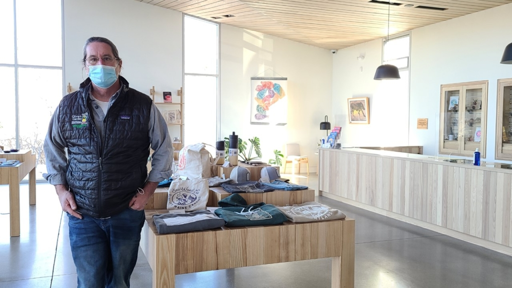 Scott Howard, owner of SeaWeed Co., one of the state's first adult-use marijuana stores, stands in his South Portland shop earlier this month. Howard has been cited by the state for using a prohibited product logo, among other issues.
