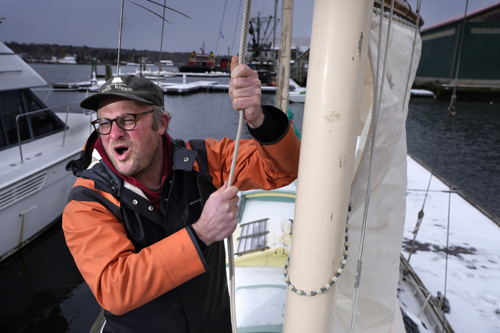 Bennett Konesni sings a sea shanty while raising a sail on his ketch on Thursday in Belfast, Maine. Konesni started singing sea shanties aboard a schooner in Penobscot Bay and has since traveled the world studying work songs. The app TikTok helped sea shanties surge into the mainstream.