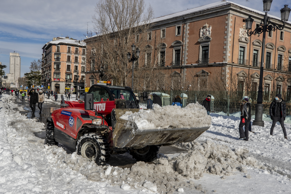 A plow clears snow in downtown Madrid on Sunday after the country was hit with the worst snowstorm in recent memory.