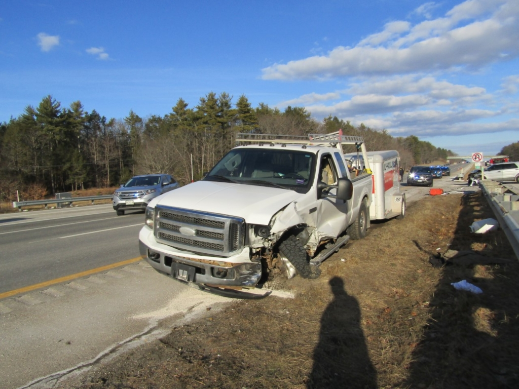 A damaged 2002 Ford Super Duty pickup towing a U-Haul trailer sits beside the southbound lanes of the Maine Turnpike on Tuesday after the driver, David Stoddard, 49, of Topsham, led police on a high-speed chase from Kennebunk to York, according to Maine State Police. The pursuit ended when Stoddard crashed near mile marker 4.