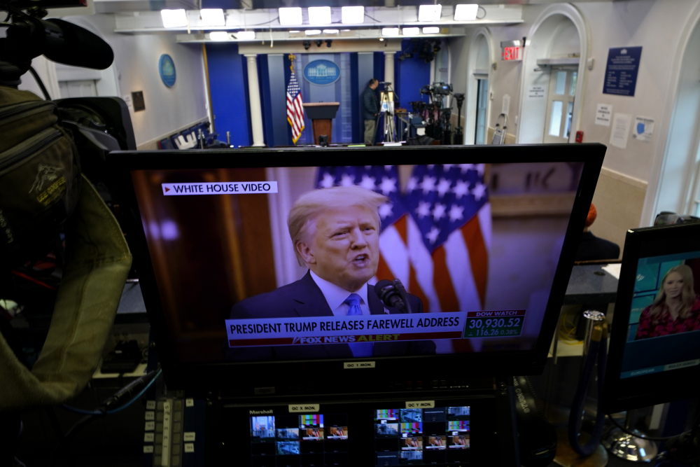 President Trump is seen on a network monitor after his pre-recorded farewell speech was released, inside the Brady Press Briefing Room at the White House on Tuesday in Washington.