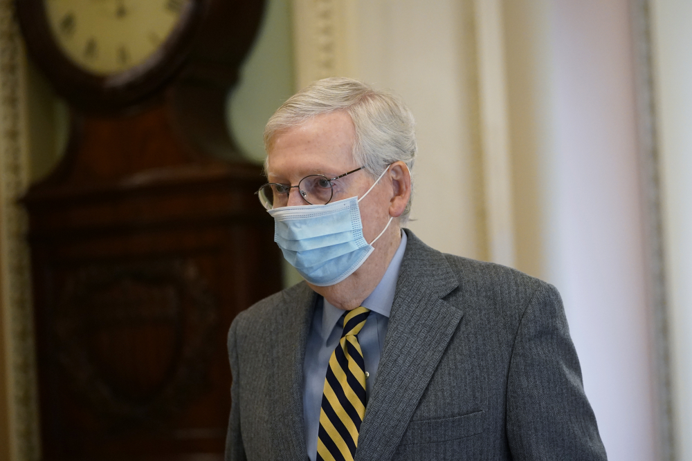 Senate Majority Leader Mitch McConnell of Ky., walks to the Senate floor Dec. 30 on Capitol Hill in Washington.