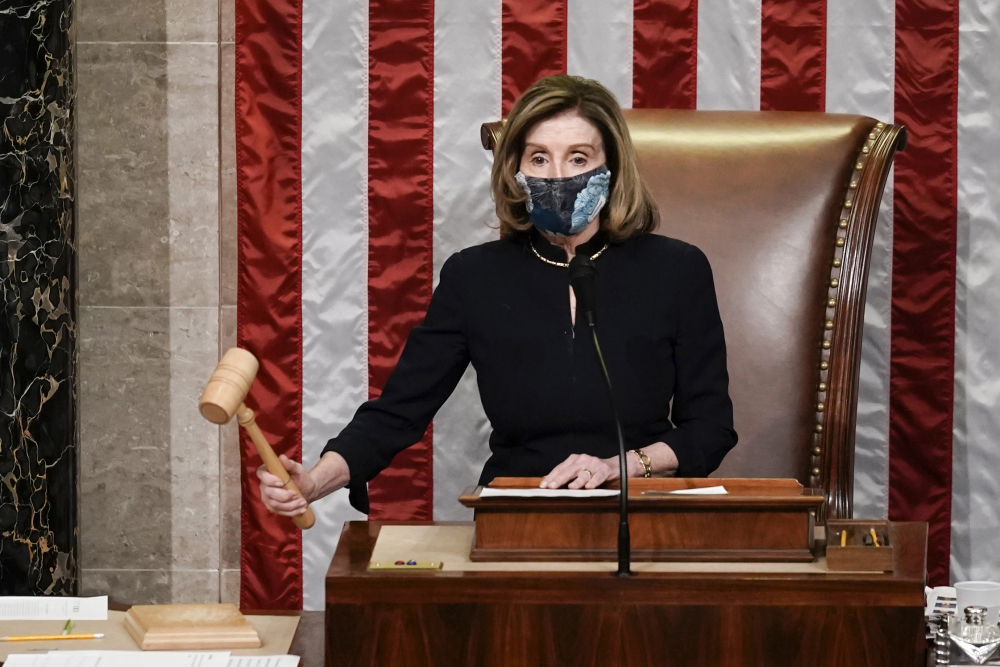 Speaker of the House Nancy Pelosi, D-Calif., gavels in the final vote of the impeachment of President Trump, for his role in inciting an angry mob to storm the Congress last week, at the Capitol in Washington on Wednesday.