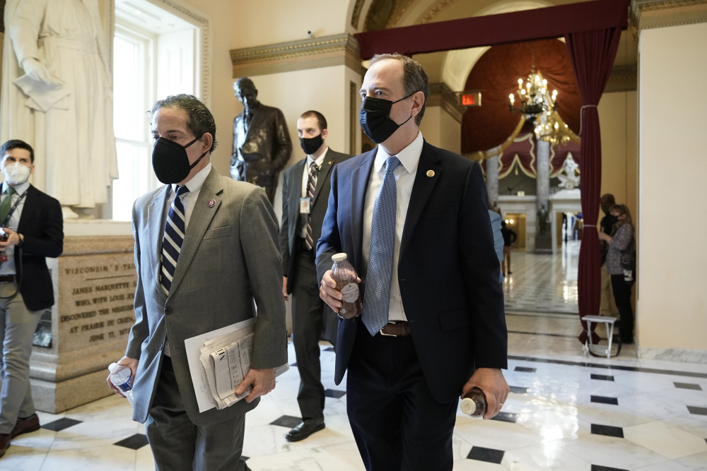 Rep. Jamie Raskin, D-Md., left, walks with Rep. Adam Schiff, D-Calif., at the Capitol in Washington, on Wednesday as the House pursues an article of impeachment against President Trump for his role in inciting an angry mob to storm the Capitol.