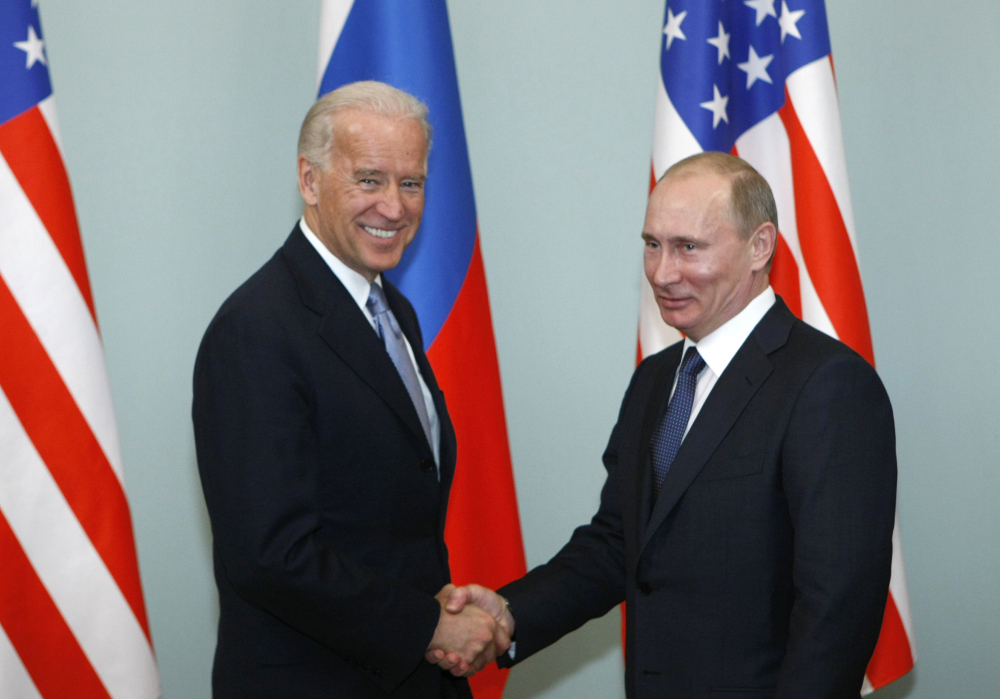 Then-Vice President Joe Biden shakes hands with Russian Prime Minister Vladimir Putin in Moscow, Russia, in 2011. President  Biden has been thrown into a high-wire act with Russia as he seeks to toughen his administration's stance against Putin while preserving room for diplomacy in a post-Donald Trump era.