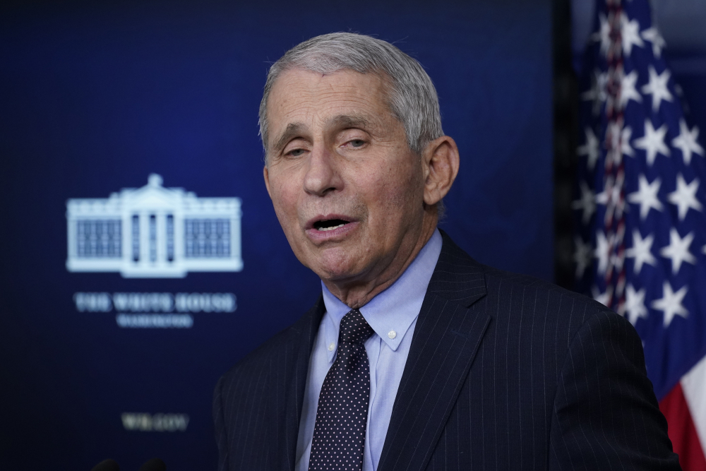 Dr. Anthony Fauci, director of the National Institute of Allergy and Infectious Diseases, speaks with reporters in the James Brady Press Briefing Room at the White House in Washington on Jan. 21.