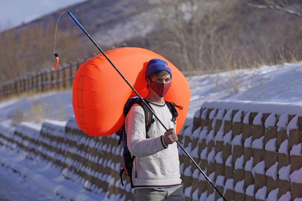 Cameron French of  White Pine Touring wears an Ascent 40 AVABAG avalanche backpack on Dec. 18  in Park City, Utah. With another ski season getting underway, avalanche forecasters and search-and-rescue groups are concerned that large numbers of skiers and snowboarders will again turn to the backcountry to avoid crowds and reservation systems at resorts. The increased interest in the backcountry has been a lifeline for the outdoor retail industry amid the pandemic, but it has also renewed a push among gear manufacturers and stores to sell responsibly.