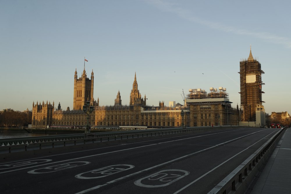 An almost empty Westminster Bridge stands backdropped by the early morning sun on the scaffolded Houses of Parliament and the Elizabeth Tower in London on March 24, 2020 – the first day of Britain's first lockdown. Critics say the government's slow response as the virus emerged from China was the first in a string of lethal mistakes.