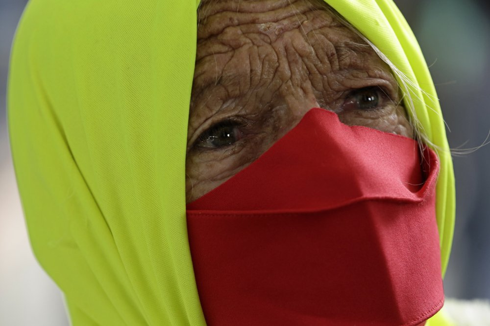 A woman participates in a protest against Brazilian President Jair Bolsonaro's handling of the pandemic in Brazilia on Dec. 23.