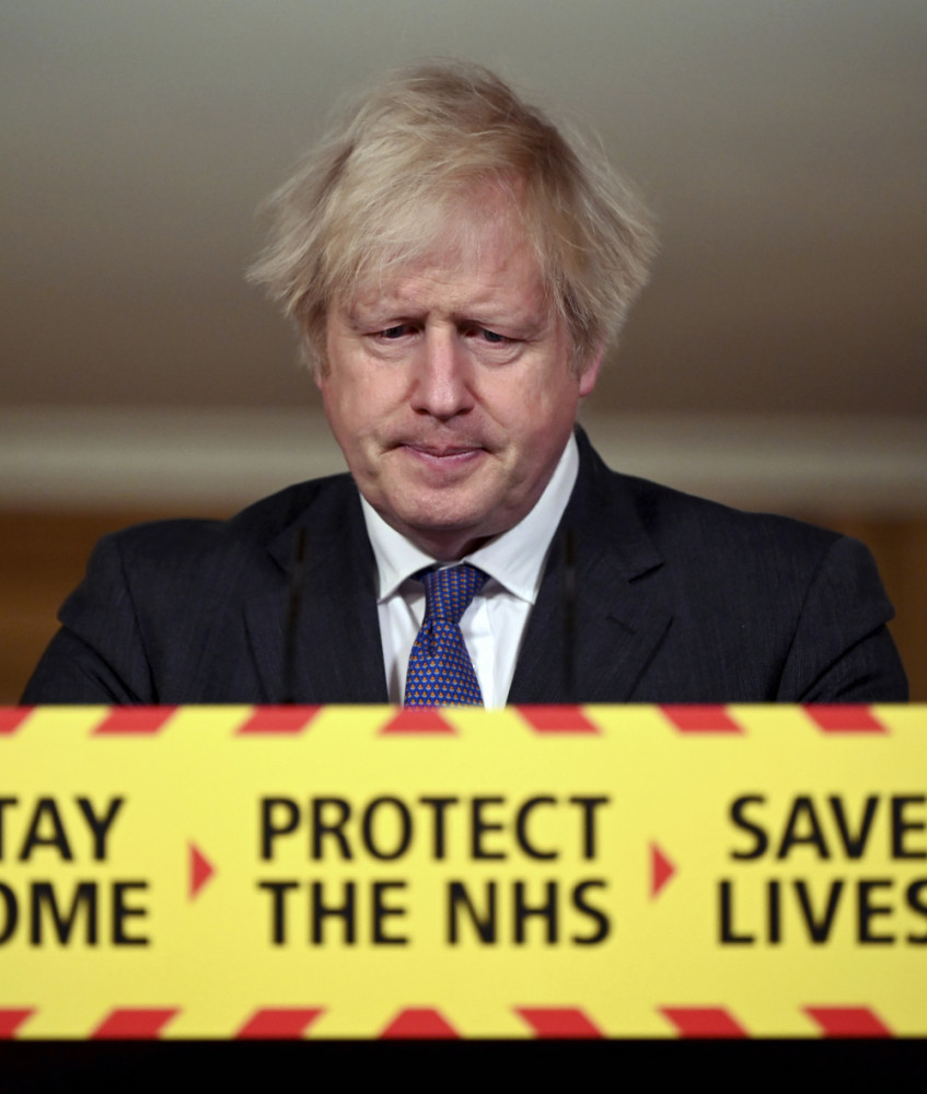 Britain's Prime Minister Boris Johnson speaks during a coronavirus press conference at 10 Downing Street in London, Friday Jan. 22. Johnson announced that the new variant of COVID-19, which was first discovered in the south of England, may be linked with an increase in the mortality rate.