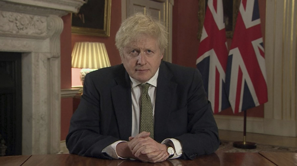 In this image taken from video, Britain's Prime Minister Boris Johnson makes a televised address to the nation from 10 Downing Street, London, on Monday, setting out new emergency measures to control the spread of coronavirus in England.