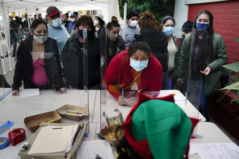 People check in at a food bank in Los Angeles in December.