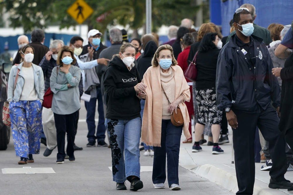 People arrive at Jackson Memorial Hospital to receive the COVID-19 vaccine in Miami on Jan. 6, 2021.