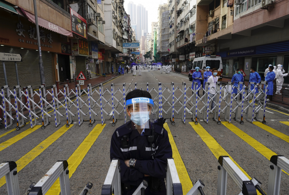 A police officer stands guard in the Yau Ma Tei area of Hong Kong on Saturday.