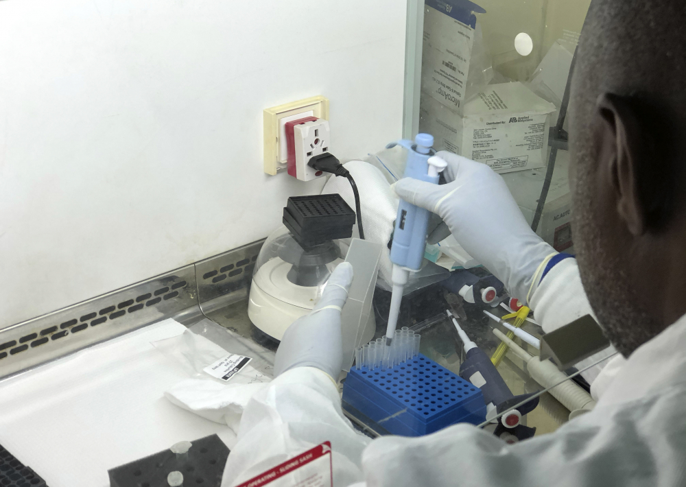 Virologist Sunday Omilabu works in a lab in Nigeria in December trying to gather information about a variant form of the coronavirus that is more highly contagious. American officials warn that the variant could become the dominant form of the virus in the United States by March.