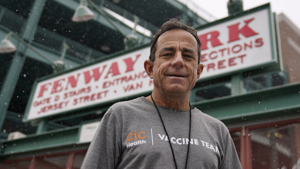 Boston Marathon Race Director Dave McGillivray, shown on Thursday outside Fenway Park in Boston,  has been asked by the state of Massachusetts to run mass vaccination operations at Gillette Stadium and Fenway Park. Event organizers and other unconventional logistics experts are using their skills to help the nation vaccinate as many people against COVID-19 as possible.