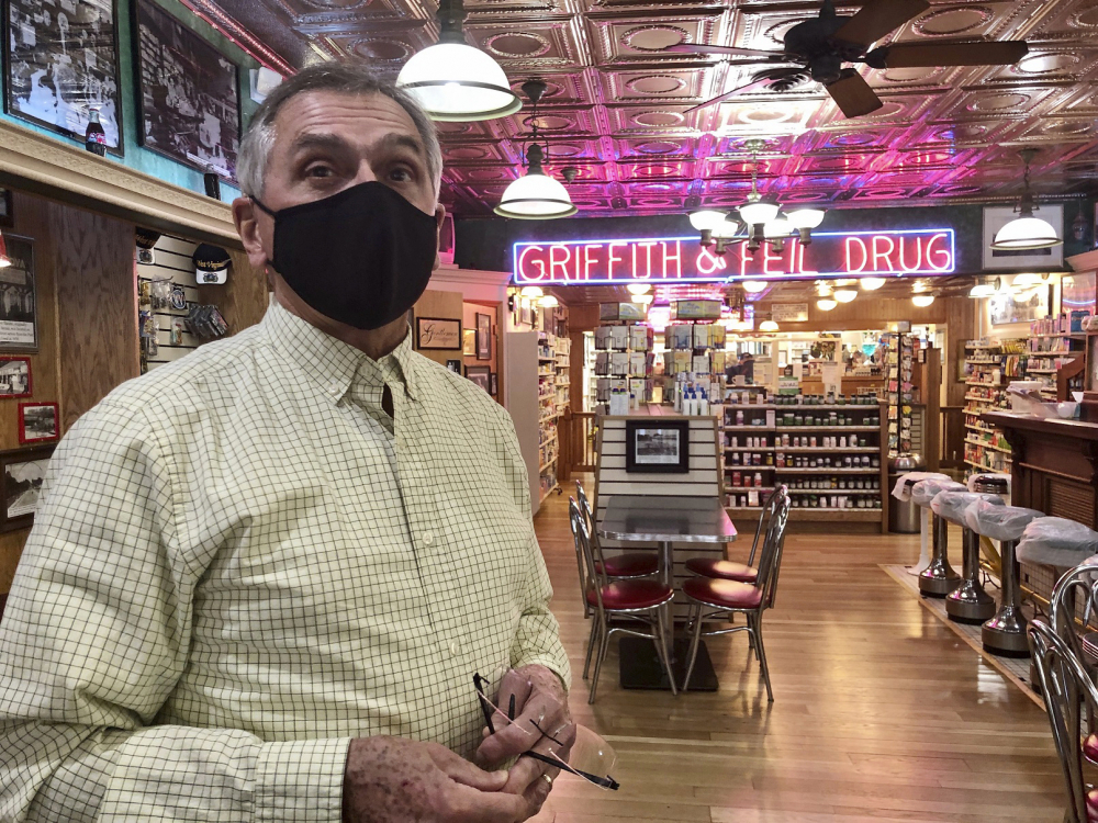 Pharmacist Ric Griffith stands in his family's business Friday, in Kenova, W.Va. Griffith & Feil is among 250 mom-and-pop pharmacies in West Virginia helping to vaccinate residents in the quest to banish the coronavirus pandemic.